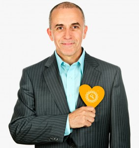 Man with paper heart on white background